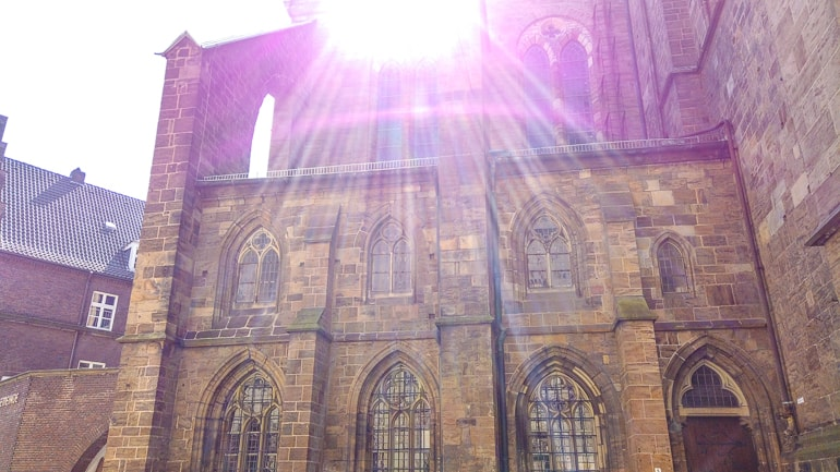 sun rays shine on brick walls and old windows of cathedral bremen germany