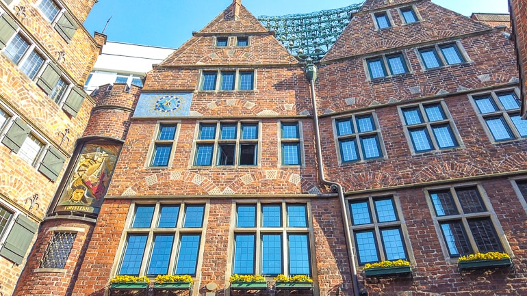 old clock on red brick building in bremen germany