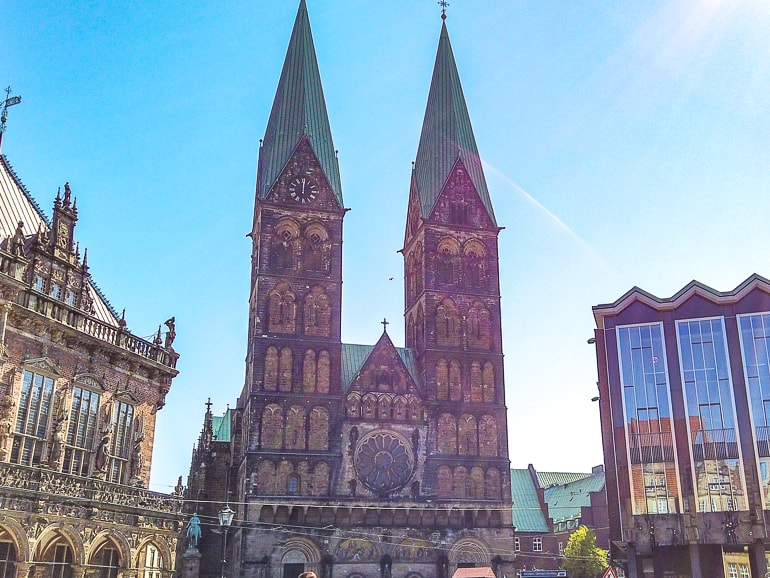 two towers of cathedral on bremen germany with blue sky behind