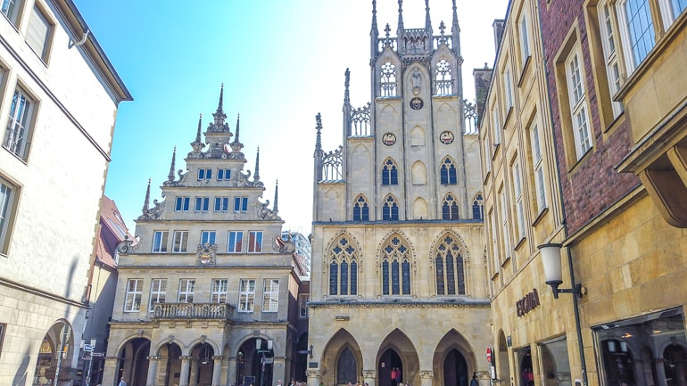 historic buildings with tall facades in old town munster germany