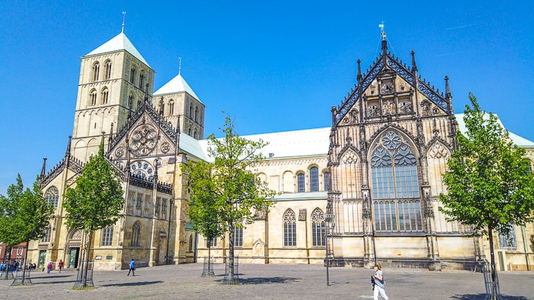 cathedral with blue sky and trees in front munster germany things to do