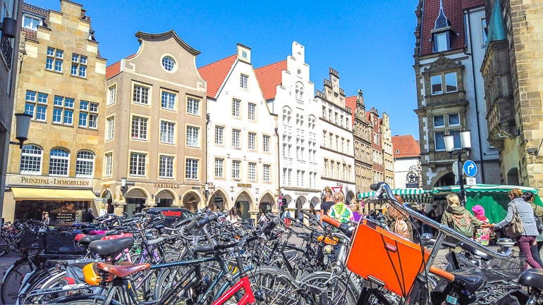 bikes parked in old town square with houses around things to do in munster germany