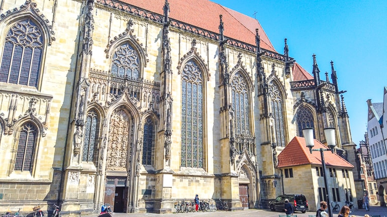 cathedral windows with red roof in old town square munster germany