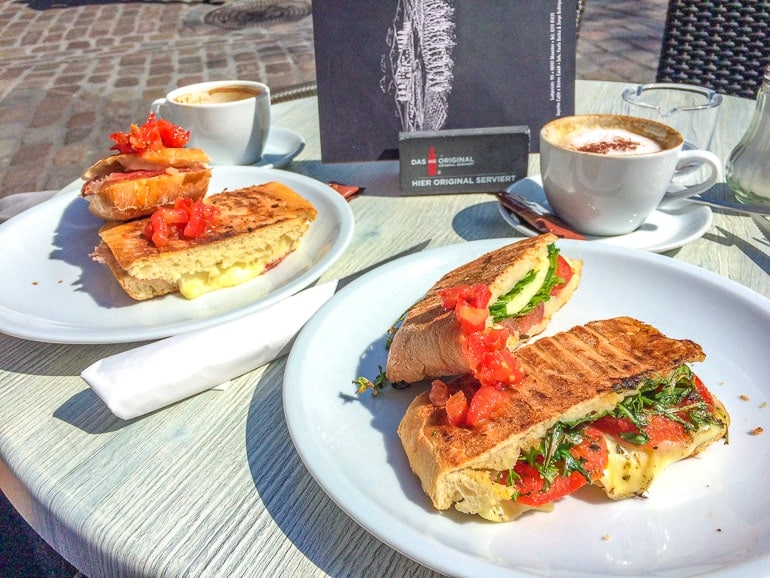 ciabattas on plates with coffees on table in munster germany