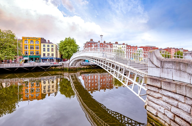 white bridge over river with houses across where to stay in dublin