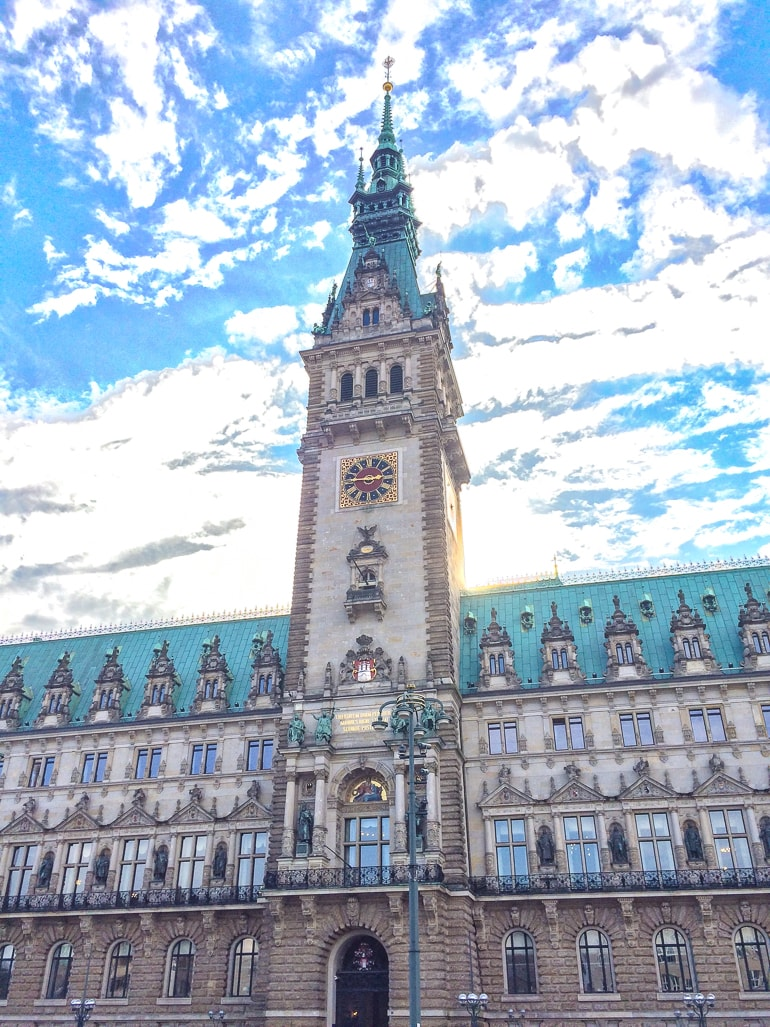 old german town hall with clock tower where to stay in hamburg altstadt