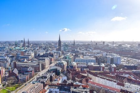 city buildings from tower with blue sky in hamburg city centre