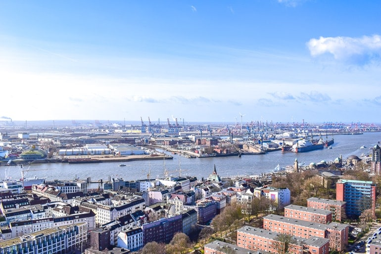 waterfront port with cranes and neighbourhood st pauli where to stay in hamburg