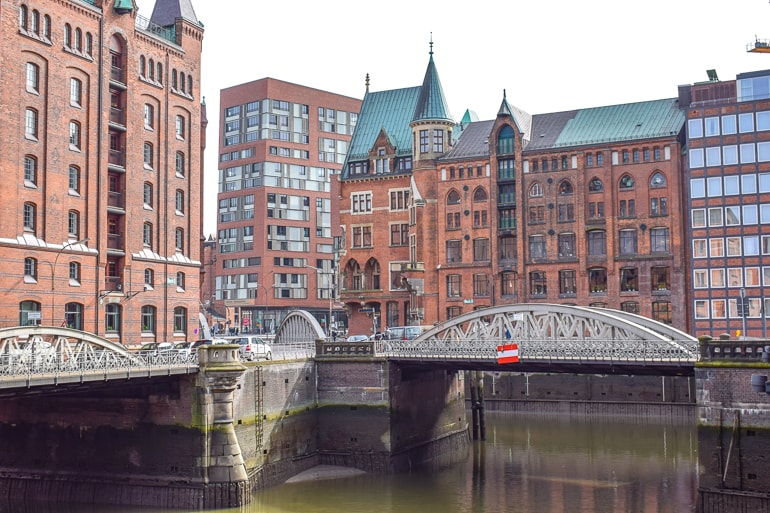 red brick factories and water canals with metal bridges where to stay hamburg