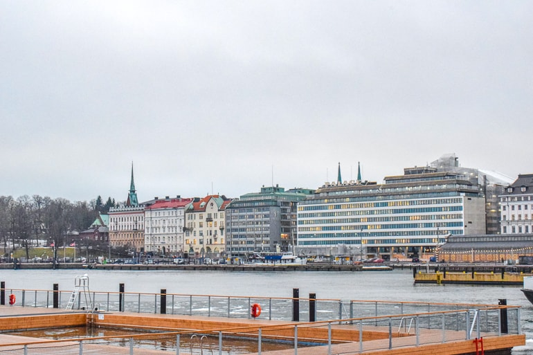 hotel buildings along harbourfront with frozen harbour in front helsinki