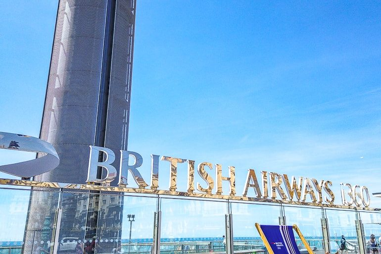 metallic british airways sign on wall with blue sky behind brighton things to do