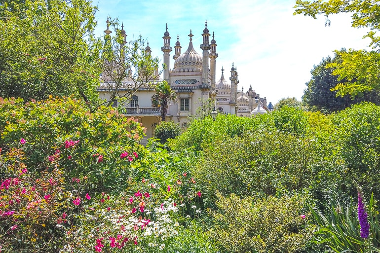 green gardens with flowers and palace in behind in brighton