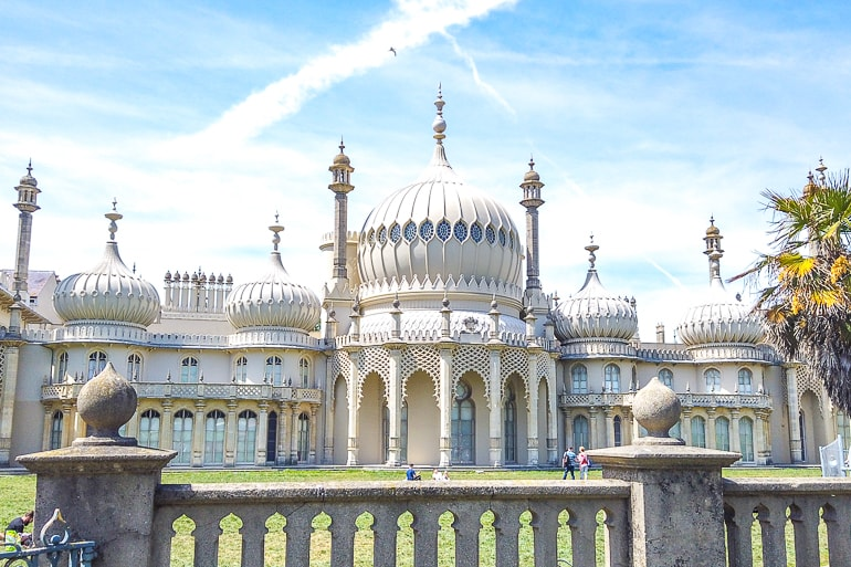 white palace with towers and green grass in front brighton