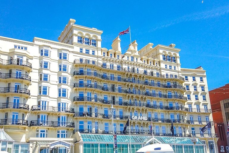 yellow hotel with balconies overlooking waterfront where to stay in brighton