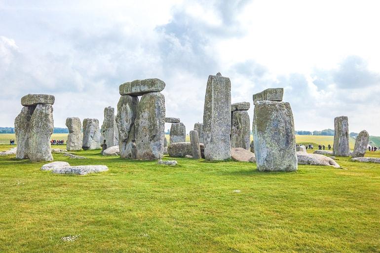 stones with green grass around at stonehenge historic site