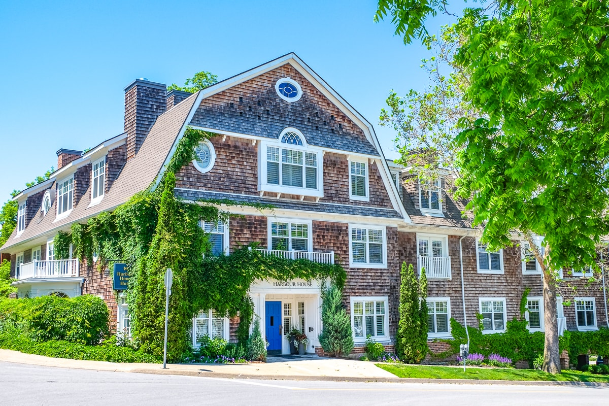 wooden inn with white windows and blue door niagara on the lake accommodations