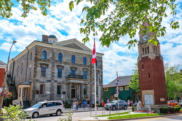 old town hall with brick cenotaph and cars on the street niagara on the lake accommodations