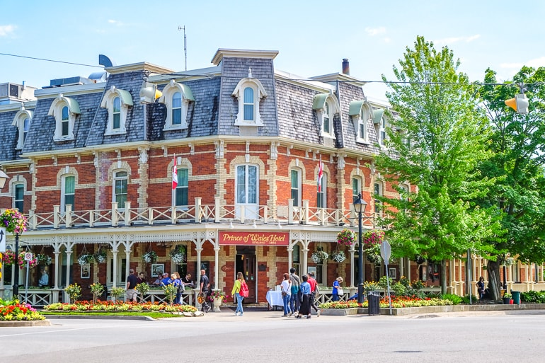 old hotel on street corner with red brick and gardens niagara on the lake accommodations