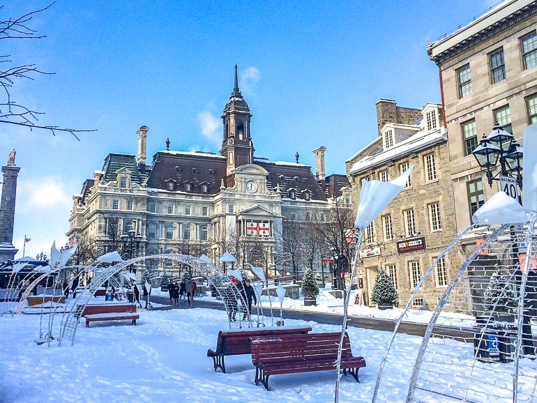 large historic building at top of street with snow covered sidewalk in old montreal