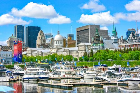 boats in water with historic buildings behind things to do in montreal