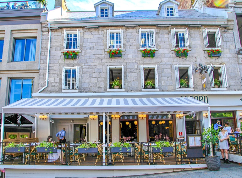 old limestone building with awning over restaurant in old montreal