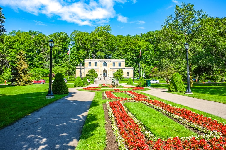stone building with colourful flower gardens in front niagara falls canada parks