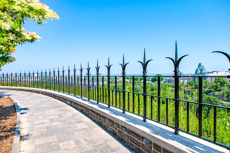 iron fence with river and greenery behind ottawa river