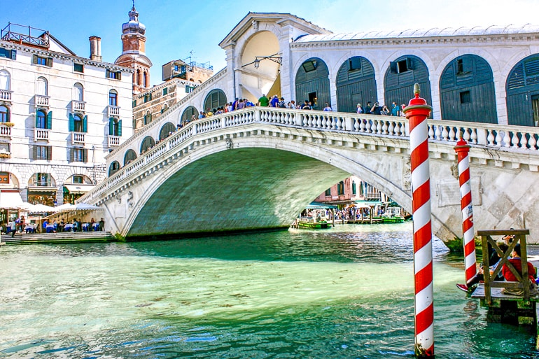 white decorated rialto bridge over blue canal Venice italy one day