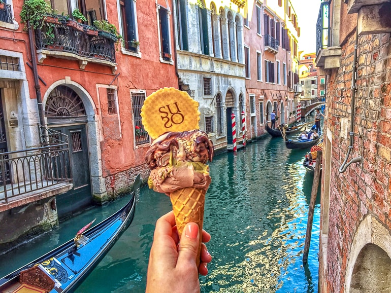 gelato in cone with cookie over venice canal one day in venice