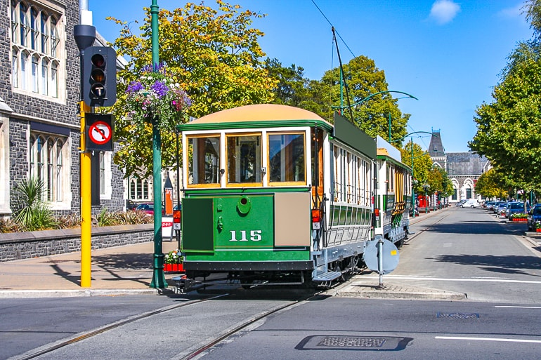 old street car on roadway in city in new zealand