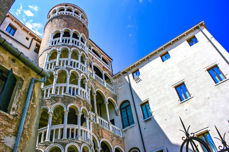 spiral staircase beside building things to do in venice italy