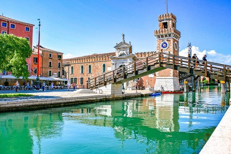 brown bridge and tower over water things to do in venice Venetian Arsenal