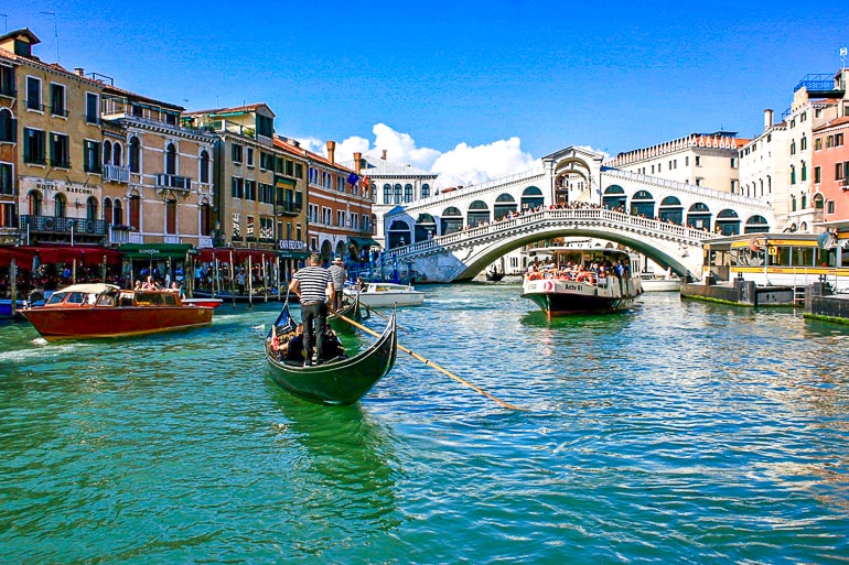 bridge over canal with boats in front rialto bridge things to do in venice