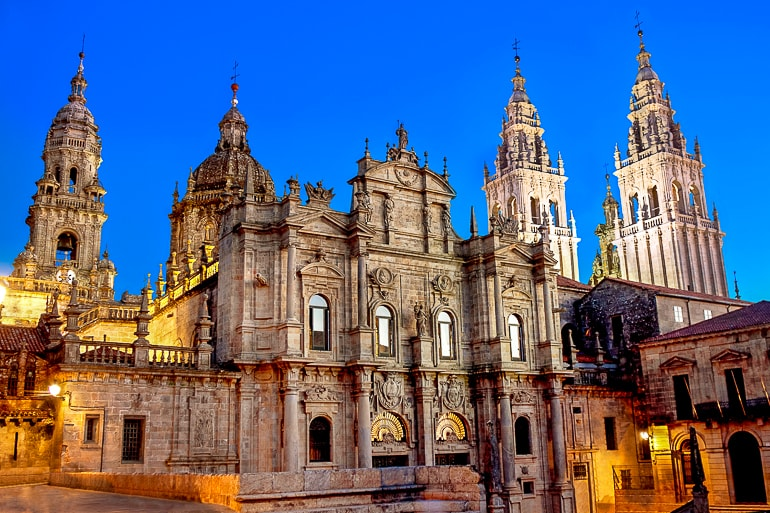 decorated spires of cathedral lit up at night top attractions spain cathedral santiago