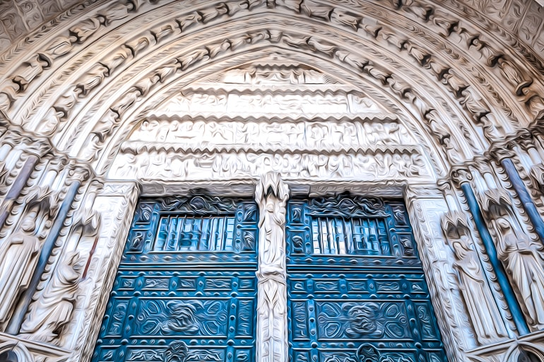 blue cathedral door with white dome around in toledo top attraction
