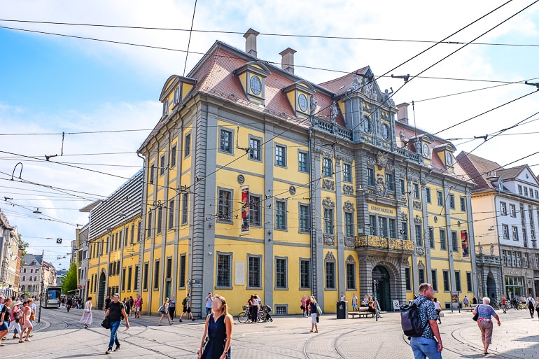 yellow historic museum on busy street corner things to do in erfurt germany