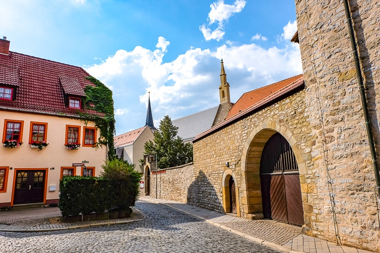 large stone wall with gate and building behind in erfurt germany old town