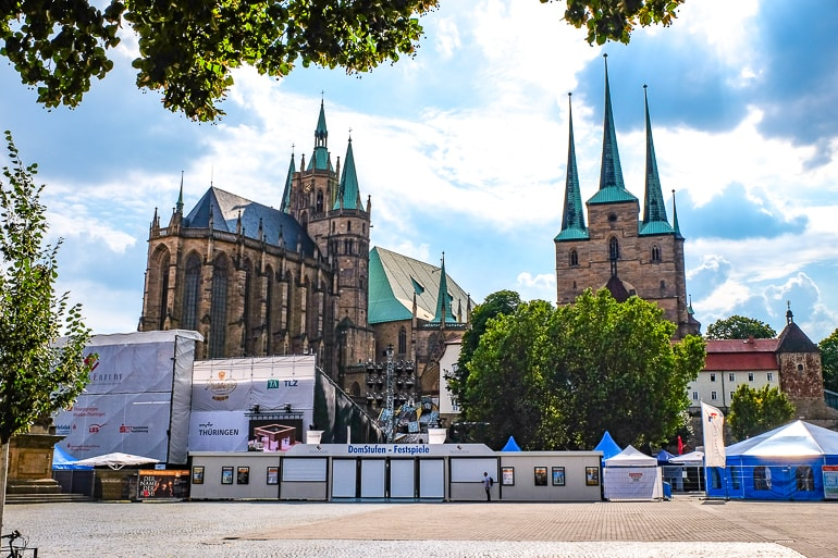 two churches with green spires on hilltop things to do in erfurt germany