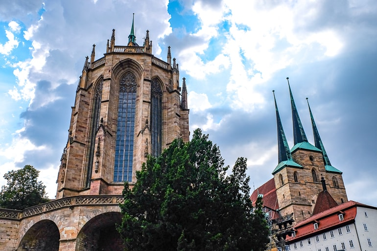 large cathedral and church with windows and spires from below erfurt germany