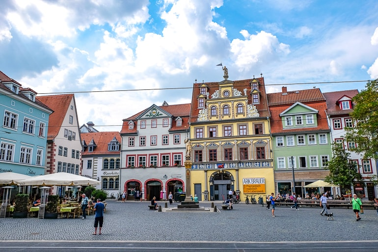yellow old town building with square in front things to do in erfurt germany fischmarktplatz