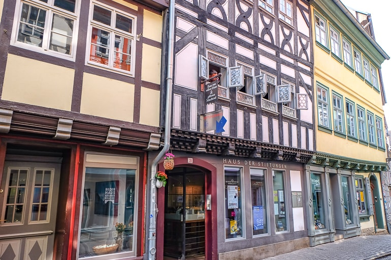 open museum entrance along other wooden colourful shops on old bridge in erfurt germany
