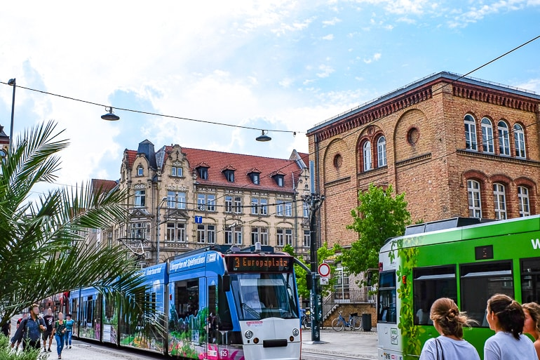 street cars running through german town with buildings behind erfurt germany