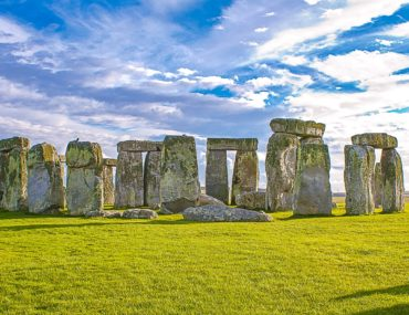 rocks in a circle on green grass visiting stonehenge
