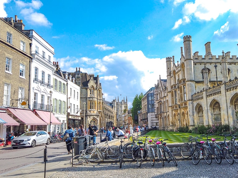 old english town buildings with bikes parked and people in cambridge uk