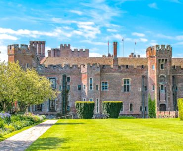 red brick herstmonceux castle with green gardens day trips from london