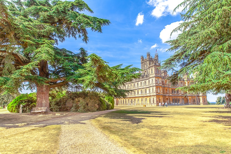 tall castle tower with trees in front downton abbey
