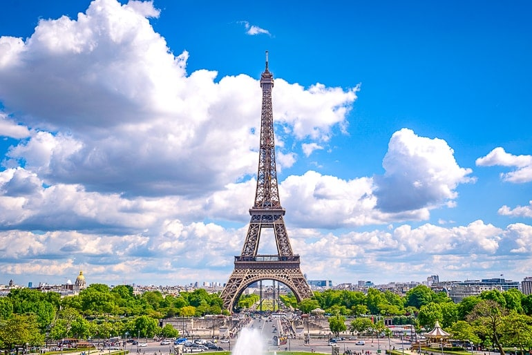 steel tower eiffel tower with blue sky behind day trip from london paris