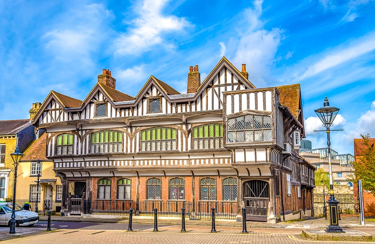old wooden building with brown timber and blue sky behind in southampton