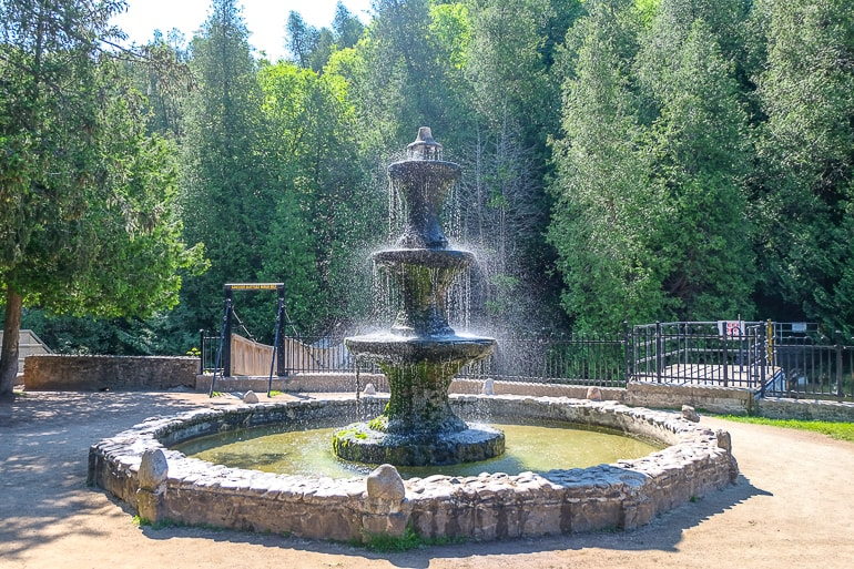 fountain spraying water with green trees behind caledon day trip from toronto