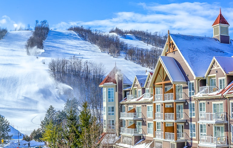 chalet with snowy ski runs behind blue mountain collingwood